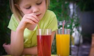Girl enjoying fruit juice